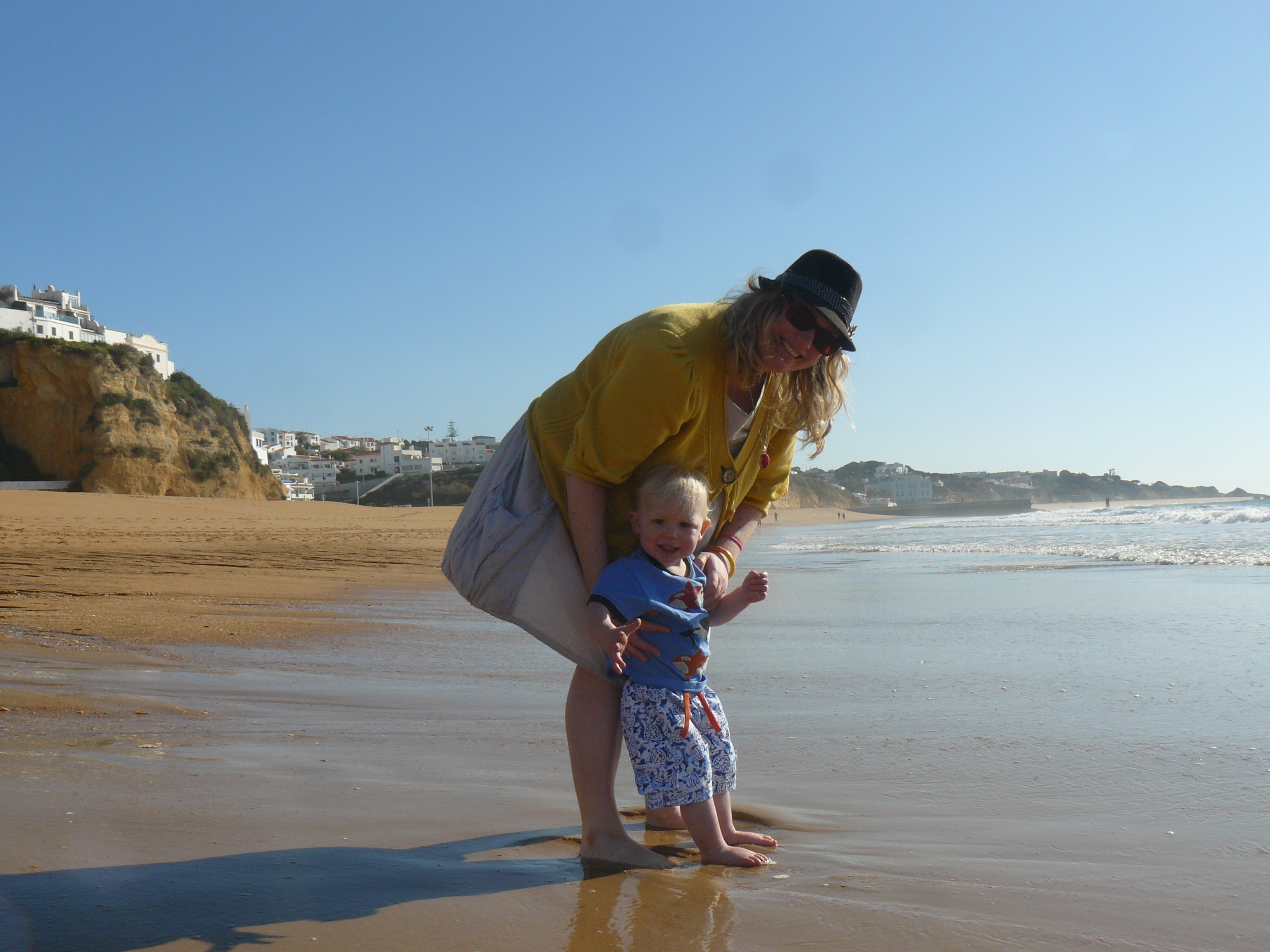 family travel, beach with mother and son, portugul