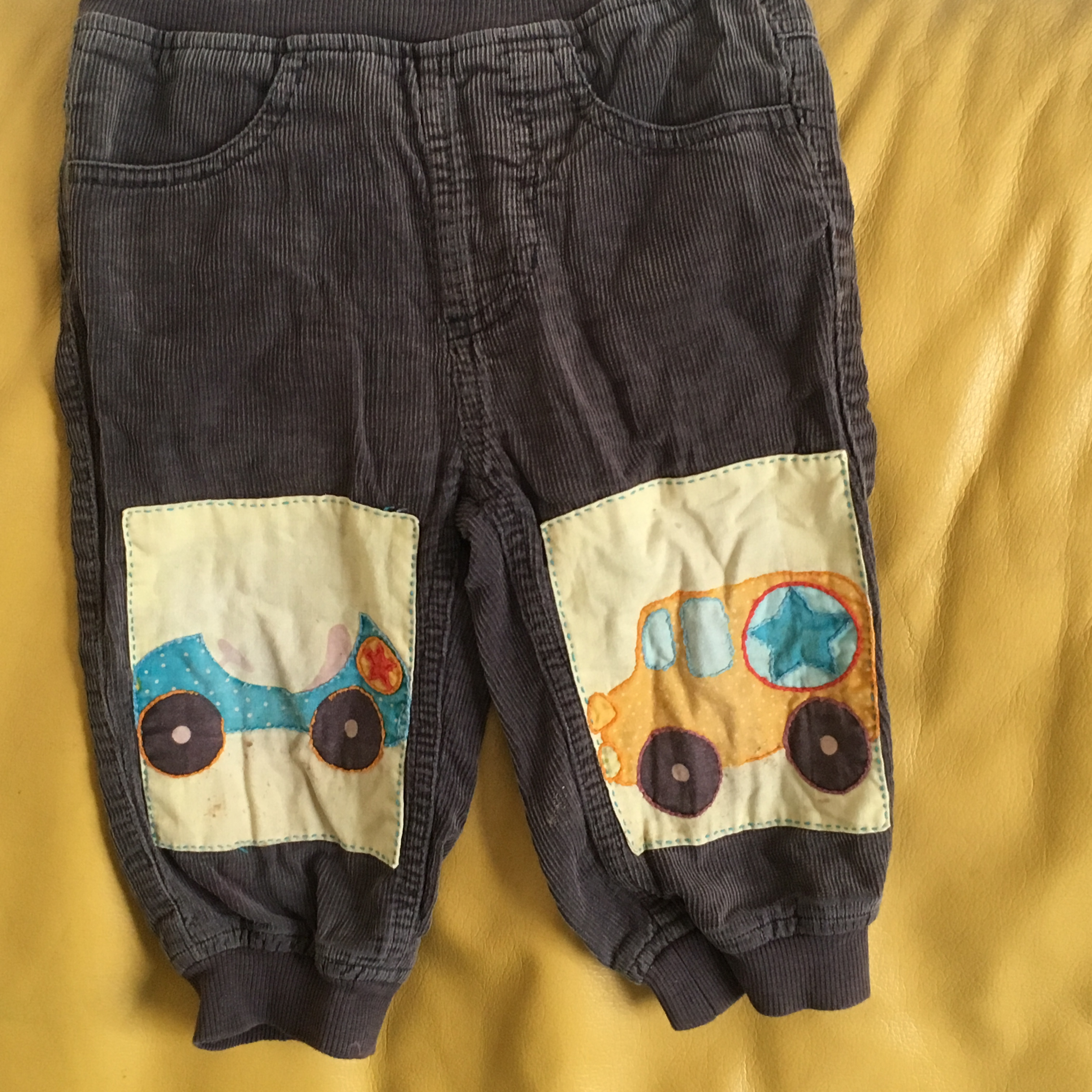 Hand stitched vehicle patches on children's trousers