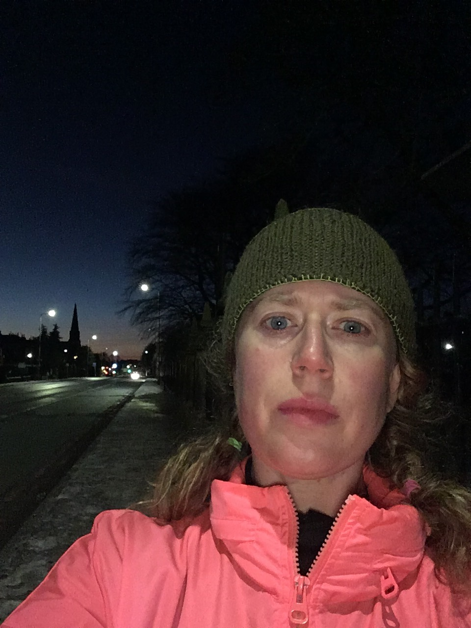 RWoman in pink in a run selfie on the streets of Edinburgh
